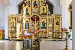 Font with a pulpit, an iconostasis and altar of the Russian Orthodox cathedral hall. Belgorod, Russia - May 20, 2017: Font with a pulpit, an iconostasis and Stock Photo