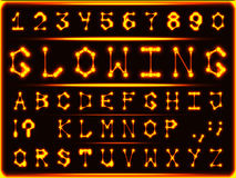The font of red-hot glowing gold. Robotic font-style hot glowing gold. The letters and numbers Stock Images
