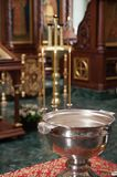 Font in the temple on the child`s baptism with candles Royalty Free Stock Photo
