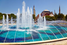The fontain  in Sultan Ahmet Park with Hagia Sophia in the backg Stock Photo