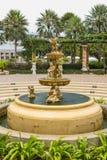 Fontaine avec de petits anges Photo stock