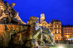 The Fontaine Bartholdi and Lyon city hall, place des terreux. View of theFontaine Bartholdi and Lyon city hall at lyon old town by night shot Stock Image