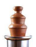 Fontaine de fondue de chocolat d'isolement sur le blanc Images stock