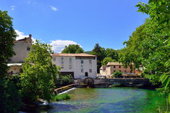Fontaine de Vaucluse. Medieval Village Fontaine de Vaucluse on the river shore. The poet Petrarch made it his preferred residence in the 14th century royalty free stock images