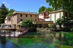 Fontaine de Vaucluse. PROVENCE, FRANCE - JUL 8, 2014: Medieval Village Fontaine de Vaucluse on the river shore. The poet Petrarch made it his preferred residence royalty free stock photography