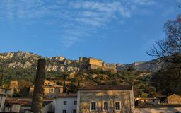Fontaine-de-Vaucluse street view with the ruins of the castle in France royalty free stock image