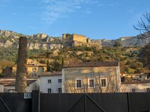 Fontaine-de-Vaucluse street view with the ruins of the castle, Provance, France royalty free stock photo