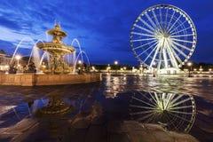 Fontaine des Fleuves and Ferris Wheel on Place de la Concorde in Stock Photos