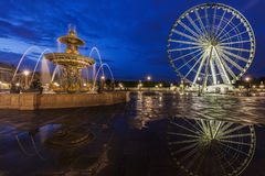 Fontaine des Fleuves and Ferris Wheel on Place de la Concorde in Royalty Free Stock Image