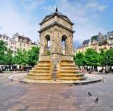 Fontaine des Innocents, Paris. The fountain Fontaine des Innocents (The Fountain of the Innocent) in the center of Paris, France stock photo