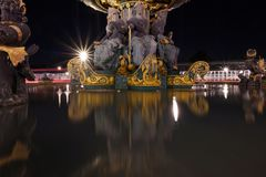 Fontaine des Mers. At the Place de la Concorde it is reflected on the water, Paris, France stock photos