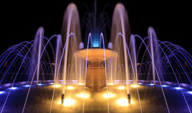 Fontaine la nuit Images stock
