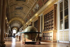 The Fontainebleau Castle library. The ancient library of the Fontainebleau Castle near Paris. Decorated by famous painters, decorated with wooden shelves and Royalty Free Stock Photography