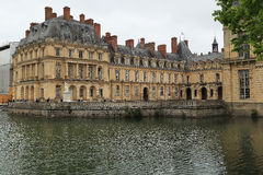 Fontainebleau Palace from the pond Royalty Free Stock Images