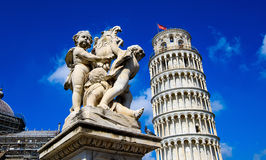 Fontana dei Putti and Leaning Tower of Pisa in Piazza dei Miracoli Square of Miracles in Pisa, Tuscany Stock Images