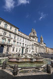 Fontana del Moro and church of Sant'Agnese in Agone. ROME, ITALY - JULY 30 2015: Fontana del Moro, at the southern end of the Piazza Navona, was designed by royalty free stock photos