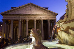 Fontana del Pantheon in Rome, with the temple and people in the background Royalty Free Stock Image