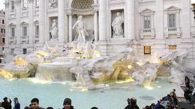 Fontana di Trevi fountain in Rome - Tilt up from tourists to sculptures on fountain stock video