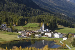 Fontana. Is idyllically situated at the foot of the mighty castle Tarasp stock photography