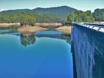 Fontana Lake and Dam. Fontana Lake is a reservoir nestled in between the Great Smoky Mountains and the Blue Ridge Mountains of Western North Carolina. Fontana stock images