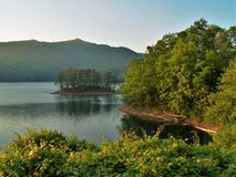 Fontana Lake and Dam Summer Sunset. Fontana Lake is a reservoir nestled in between the Great Smoky Mountains and the Blue Ridge Mountains of Western North royalty free stock photos