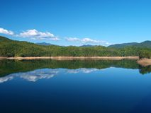 Fontana Lake Reflections. Fontana Lake is a reservoir nestled in between the Great Smoky Mountains and the Blue Ridge Mountains of Western North Carolina royalty free stock photography