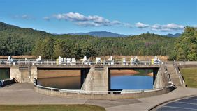Fontana Dam. Fontana Lake is a reservoir nestled in between the Great Smoky Mountains and the Blue Ridge Mountains of Western North Carolina. Fontana Dam is a stock images