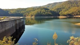 Fontana Dam. Fontana Lake is a reservoir nestled in between the Great Smoky Mountains and the Blue Ridge Mountains of Western North Carolina. Fontana Dam is a royalty free stock photos