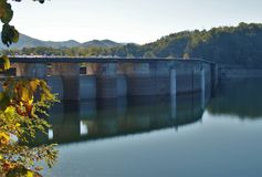 Fontana Dam. Fontana Lake is a reservoir nestled in between the Great Smoky Mountains and the Blue Ridge Mountains of Western North Carolina. Fontana Dam is a stock image