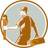 Fontanero Carry Toolbox Wrench Circle Woodcut Fotografía de archivo libre de regalías