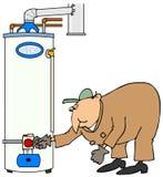 Fontanero que comprueba un calentador de agua del gas Imágenes de archivo libres de regalías