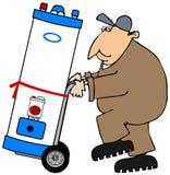 Fontanero que mueve un calentador de agua Imágenes de archivo libres de regalías