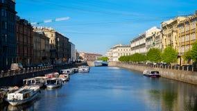 Fontanka river blue bridge and pleasure boats in Saint Petersbur Stock Images