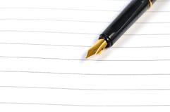 Fontanny pióro na notatniku Zdjęcia Stock