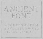 Fonte antiga Cinzelado no alfabeto de pedra da placa Alphab pré-histórico Fotografia de Stock Royalty Free