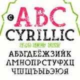 Fonte cirillica dei caratteri tipografici con grazie della lastra Fotografie Stock