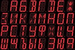 Fonte cirillica di Digital dalle lettere maiuscole sull'esposizione di LED alfanumerica rossa Fotografie Stock Libere da Diritti