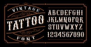 Fonte da tatuagem do vintage no fundo escuro ilustração stock