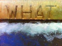Fonte de água com a palavra QUE inscrito fotografia de stock