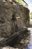 Fonte de pedra com um bico do ferro Imagem de Stock Royalty Free