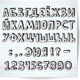 Fonte decorativa do alfabeto cirílico em um fundo de quadriculado Imagens de Stock