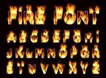 Fonte del fuoco Lettere della prugna Fonte su fuoco Fotografie Stock Libere da Diritti