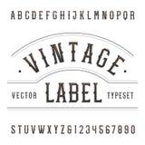 Fonte di vettore d'annata di alfabeto Scriva le lettere ed i numeri a macchina nello stile occidentale Immagine Stock