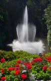 Fonte em um jardim Fotos de Stock Royalty Free