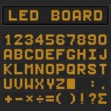 Fonte maiuscola inglese digitale arancio, numero e matematico del LED Immagine Stock Libera da Diritti