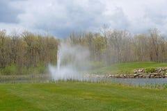 Fonte na lagoa Fotos de Stock