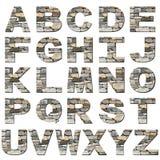 Fonte tipografica della parete di pietra Fotografia Stock Libera da Diritti