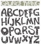 Fonte tipografica digitante di Grunge Fotografie Stock Libere da Diritti