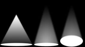 Fontes luminosas brancas na fase preta Fotos de Stock Royalty Free