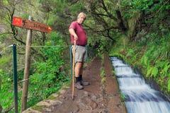 25 Fontes senior tourist hike stock photo